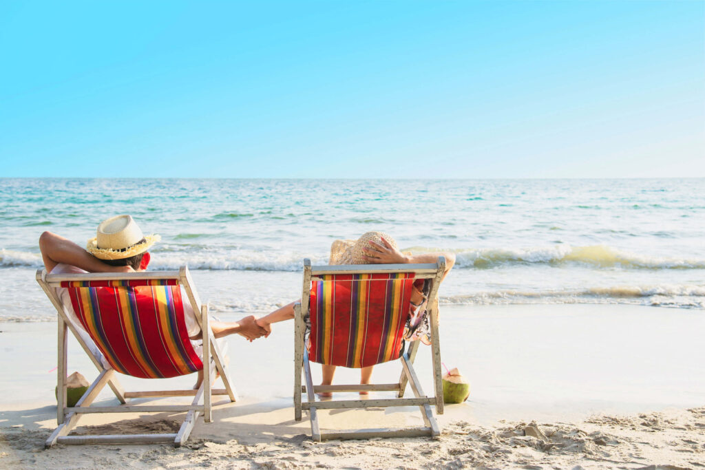 relax-couple-lay-down-beach-chiar-with-sea-wave-man-woman-have-vacation-sea-nature-concept